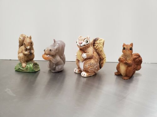 Squirrel figurine collection Set of 4 All holding nuts. Unsigned