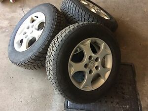 4 winter tires with mag. 205/70/15. ( 5x114.3)