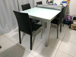 Dinning table white glass top and 6 leather chairs. Good condition.