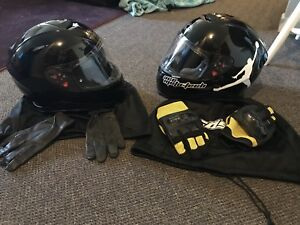 Two black matching helmets (large an small) with gloves.