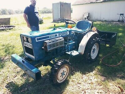 F1100 Tractor 2 Cylinder 11 Hp 4 Wheel Drive  Condition Is Used. 3 Attachments