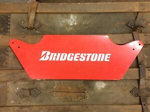 Bridgestone tires tin sign. Automotive collectible.