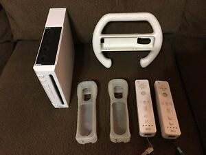 WII gaming system plus WII sports accessories and WII Pad