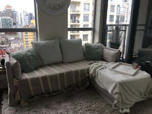 Light grey couch with versatile ottoman