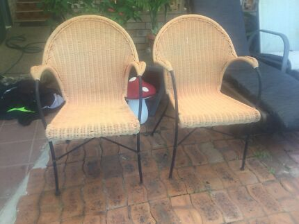 2 heavy iron and wicker chairs