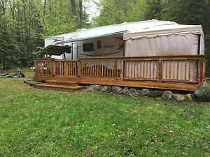 Beautiful 2010 wildcat 31ts camper/cottage package. Must read