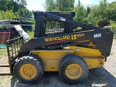 2003 New Holland Ls180 Skid Steer With 576 Hrs Two Buckets Forks Augers