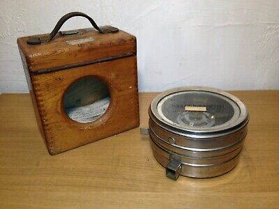 A vintage Toulet Imperator racing pigeon clock in original wooden box