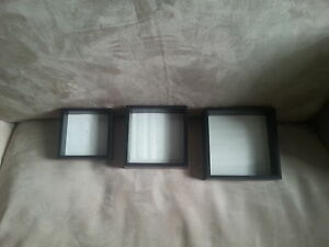 3 black floating frames