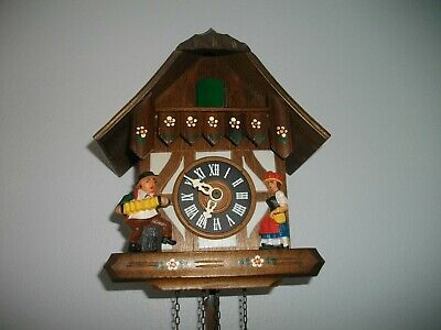 Vintage Black Forest German Chalet Style Cuckoo Clock with man and woman