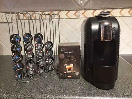 Coffee machine and coffee capsules with capsules stand.