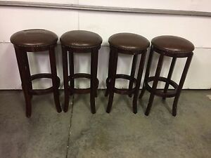 4 bar stools 29 inch hight 14 inch across $120 all brown wood