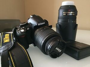 Nikon D3100 DSLR with two lenses New Cond.