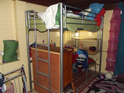 Bunk beds with inbuilt desk and chair.