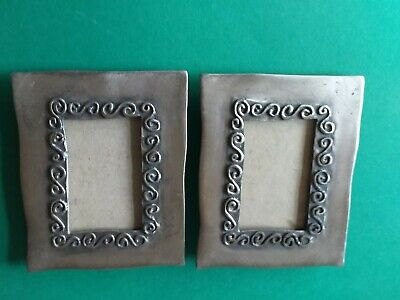 PAIR OF PEWTER NOUVEAU STYLE PICTURE FRAMES.