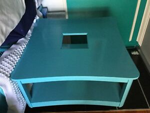Bright blue large coffee table with glass top- 1 available