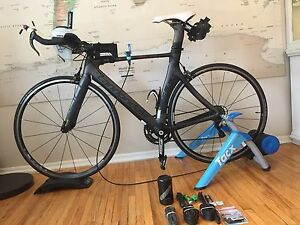 Cannondale Slice 5 105 Tri-bike with Tacx Booster trainer