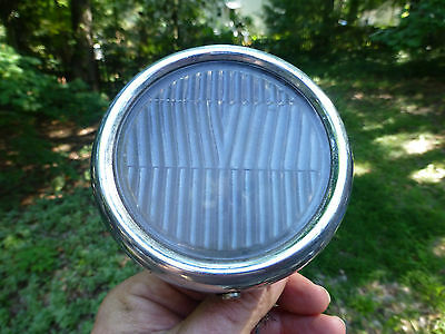 """Antique Cowl Light with a rounded bezel and glass lens 3 7/8"""" wide"""