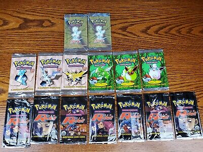 Opened Pokemon Booster Packs, 7 1st Edition Rocket, 3 1st Edition Jungle + More