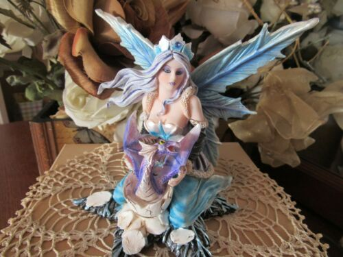Winter Queen Fairy Figurine on a star dressed in Blue with a baby dragon New!
