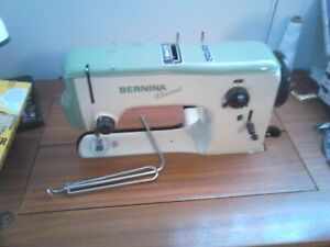 Sewing machine, cabinet and carrying case