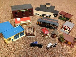 Collection of Ho scale trains and buildings