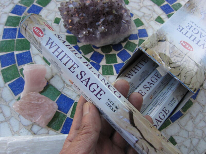 The smoke of an incense stick will clear any crystal:)