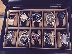 10 watches with watch box.
