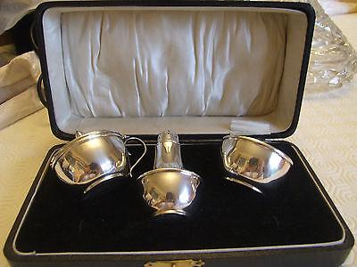 Hallmarked Silver Three Piece Condiment Set(lacking spoons). Birmingham. Boxed