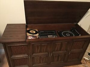 Electrohome  Radio and record player in cabinet with storage