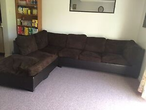 Brown sectional with queen pull out bed