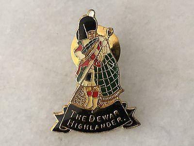 The DEWAR Highlander vintage enamel lapel pin