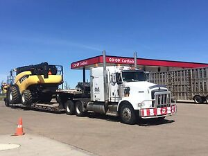 Farm equipment hauling and towing (Landoll RGN)