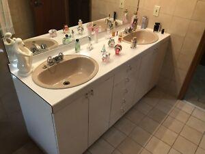 Bathroom vanity, mirror, bidet and toilet.