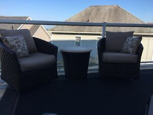 Patio recliner and swivel chairs and a round table
