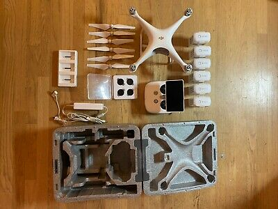 DJI Phantom 4 Pro V1 with 6x batteries, remote with built in display, and more!