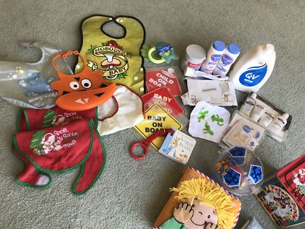 Baby bibs, creams, books and toys bundle