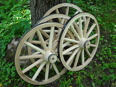FOUR DECORATIVE WOODEN WAGON CART WHEELS. HARDWOOD. MANY USES. HIGH QUAILITY.