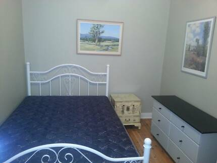 Large room available in safe quiet street close to public trans.
