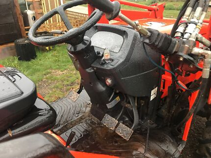 Kioti 45hp 4WD tractor with 4-in-1, carry all, forks and bucket