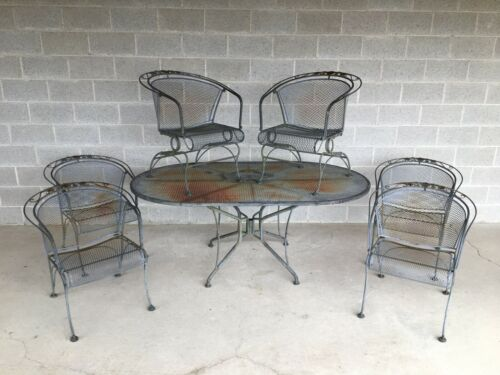 VINTAGE MID CENTURY WROUGHT IRON TABLE AND 6 MESH BARREL BACK ARM CHAIRS