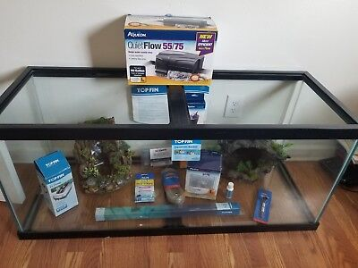 Brand new75 gallon fish tank with a few brand new accessories and 34 lbs gravel
