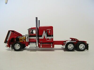 DCP FIRST GEAR 1/64 SCALE 389 PETERBILT FLAT TOP, RED WITH BLACK & SILVER STRIPE 2