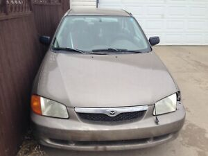 1998 Mazda protege, grey colour, tan interior