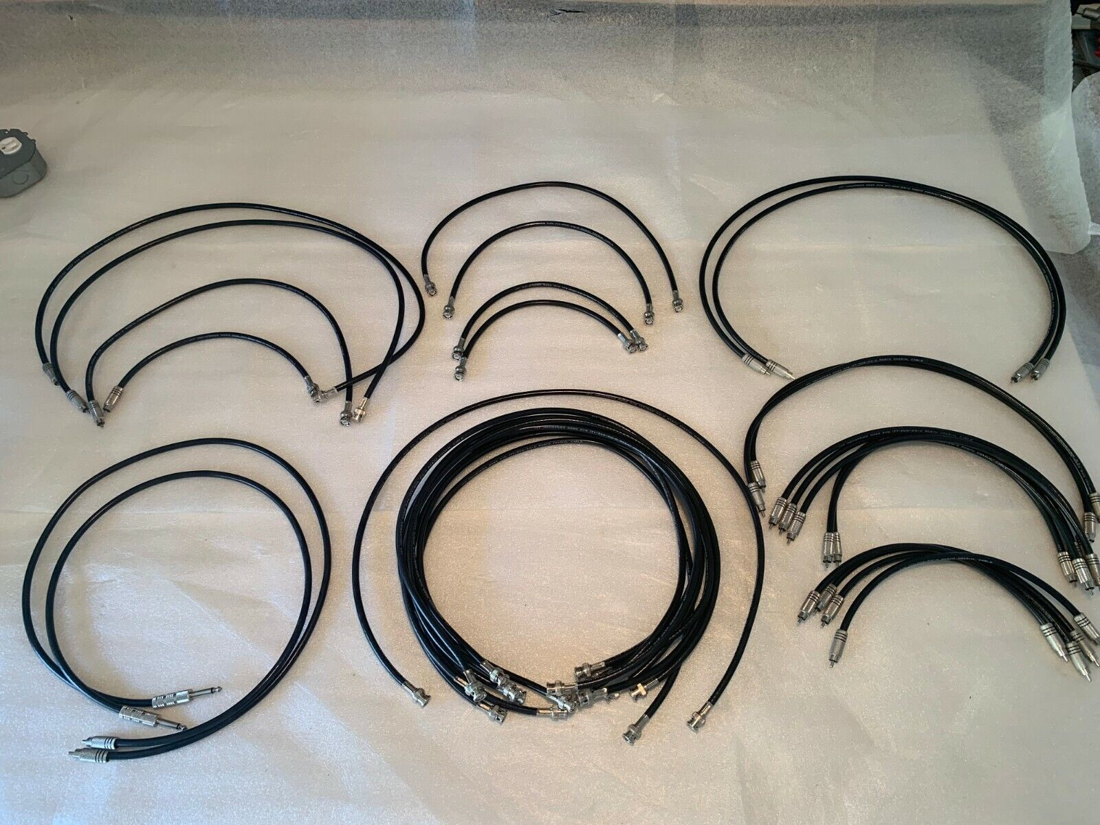 """Assorted audio and video BNC, RCA, and 1/4"""" cables"""