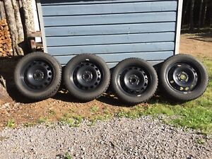 4, 205/55/16 studded winter tires and rims