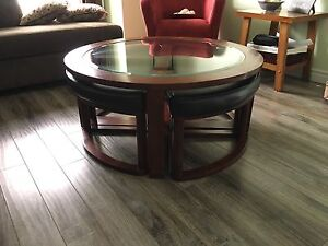 Coffee table with slide out seats