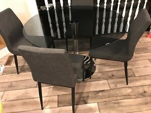 Round Tinted Glass Dining Table With 4 Grey Chairs