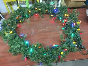 Large artificial lit Christmas wreath
