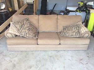 Large brown couch with studded detail.